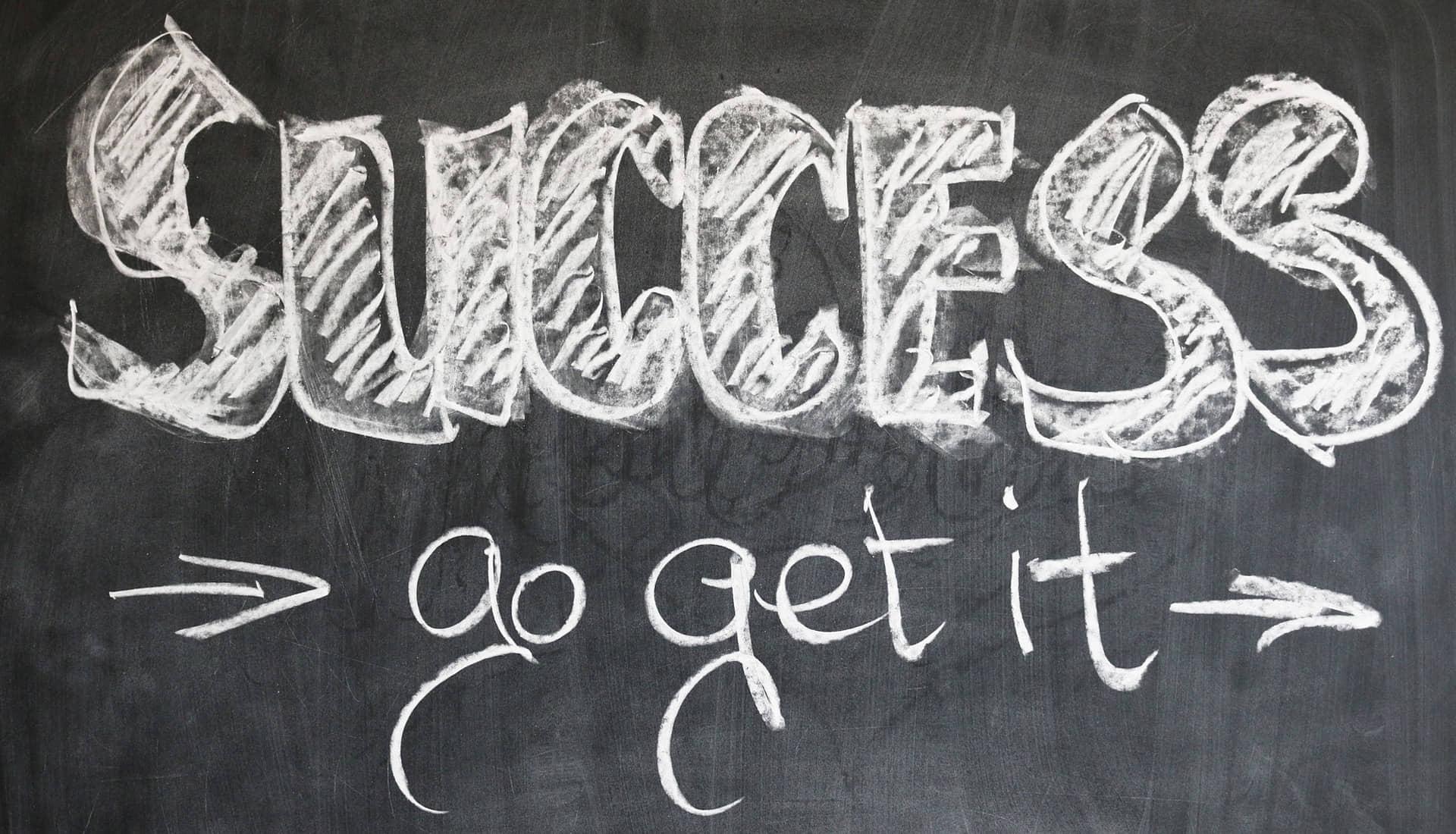 krijtbord met tekst succes go get it